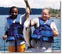 Two Girls catch a Fish Conservation Camp