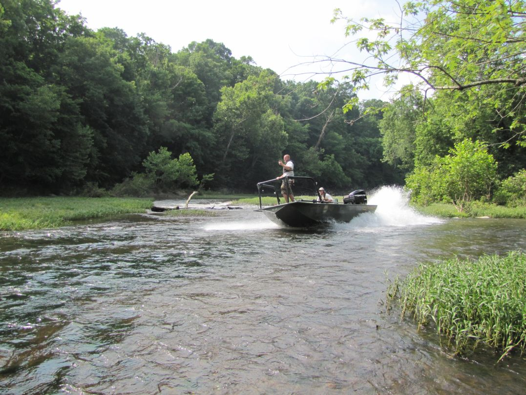 Kentucky Department of Fish and Wildlife Resource personnel navigate their way upstream in a jet drive electro-fishing boat to conduct sport fish surveys on the Green River near Greensburg, KY.