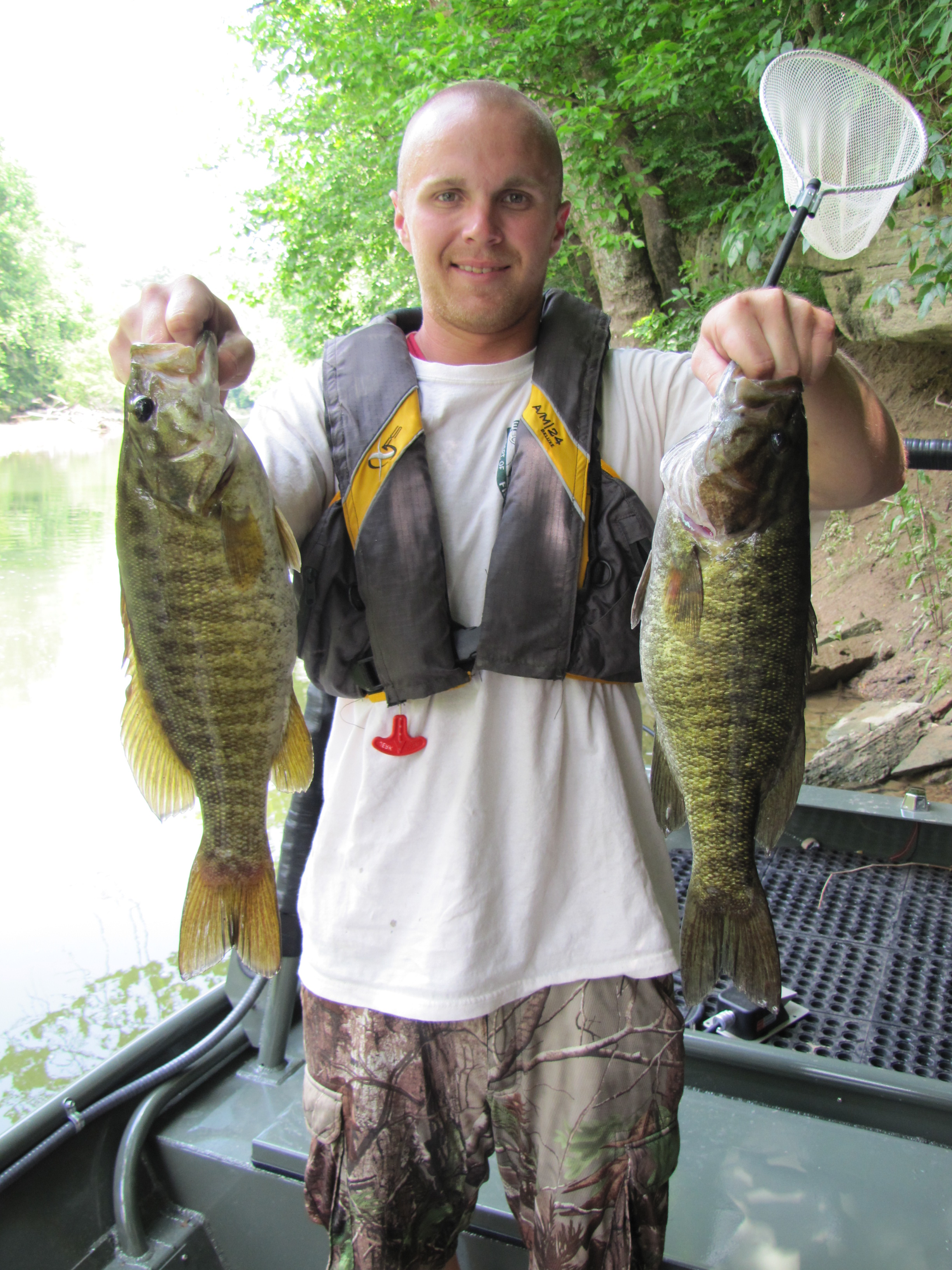 Cory Woosley shows off two, 17 inch smallmouth bass collected from the Green River near Greensburg, KY.